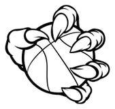 Griffe de monstre ou d'animal tenant la boule de basket-ball Photographie stock