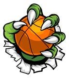 Griffe de monstre ou d'animal tenant la boule de basket-ball Photo stock