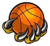 Griffe de monstre ou d'animal tenant la boule de basket-ball Images libres de droits
