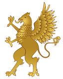 Griffin. Golden griffin - heraldic design element Royalty Free Stock Photography