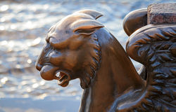 Griffin - bronze winged lion statue. Griffin - bronze winged lion on the University Embankment, St. Petersburg. Russia stock image