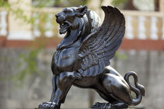 The griffin. Demon old statue Stock Photography