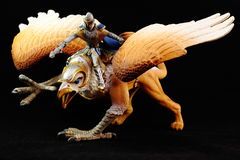 Griffin figurine toy. Isolated in black background Stock Photo