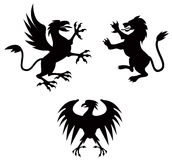 Griffin, lion and eagle Stock Images