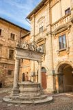 The Griffin and Lion well in the old medieval town of  Montepulciano in Tuscany Italy Stock Image