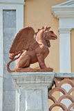 Griffin on a pedestal Stock Images