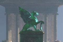 Griffin on pedestal in fog Royalty Free Stock Images