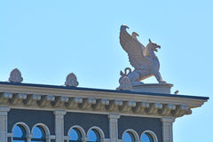 Griffin on the roof of Housing estate Venice in St. Petersburg, Russia Royalty Free Stock Photography