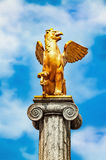 Griffin sculpture on pedestal Stock Photos