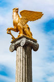 Griffin sculpture on pedestal Royalty Free Stock Image
