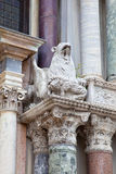 Griffin with a victim. Figure of mythological animal on the facade of Doge's Palace Stock Images