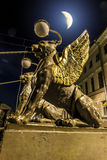 Griffins on Bank bridge across the griboyedov Canal in Moonlight Stock Photography