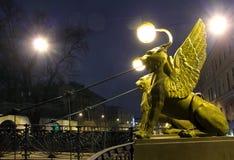 Griffins on Bank Bridge in St. Petersburg. Griffins on Bank Bridge in Saint Petersburg at night Royalty Free Stock Photos