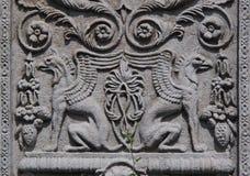 2 griffioenen in een binnenplaatstuin met schaduwen Royalty-vrije Stock Fotografie