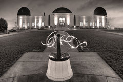 Griffith Observatory in black and white. Sundial in front of Griffith Observatory in Los Angeles, California with light painting rendered in black and white Royalty Free Stock Photos
