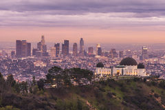 Griffith Observatory. And Los Angeles city skyline at sunset royalty free stock image