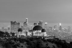The Griffith Observatory and Los Angeles city skyline. At twilight black and white stock photography