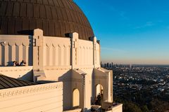 Griffith Observatory Overlooks Downtown Los Angeles at Sunset. LOS ANGELES, CALIFORNIA - NOVEMBER 19, 2017:   Griffith Observatory overlooks the downtown Royalty Free Stock Photo