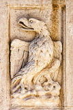 Griffon in bas-relief. On the fountain in the square at the Vaticans St. Peters Basilica in Vatican City in Rome, Italy Royalty Free Stock Photography