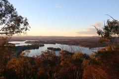 Griffon de Burley de lac au lever de soleil Images stock