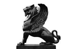 Griffon sculpture isolated on white background. Ancient  mythological animal Stock Image
