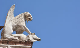 Griffon symbol of Perugia. Marble statue of the mythical beast in Palazzo dei Priori with copy space Stock Photo