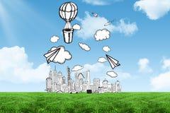 Griffonnage de ville sous le ciel bleu dans le domaine Photo stock