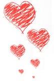 Griffonnage rouge de coeurs Photo stock