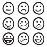 Griffonnages souriants de visages de dessin animé Photo stock