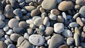 Grigio e scrivere le pietre su backround fotografia stock