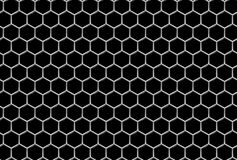 Griglia d'acciaio con il fondo senza cuciture industriale dei fori esagonali Fotografie Stock