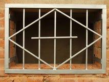 Griglia del metallo nella finestra Immagini Stock Libere da Diritti