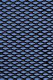 Griglia del metallo sopra priorità bassa blu Fotografia Stock Libera da Diritti