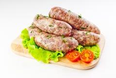 Griglia delle salsicce maiale/del manzo Fotografie Stock
