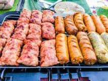 Griglia fermentata della salsiccia e della carne di maiale Fotografia Stock