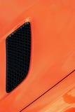 Griglia nera della presa d'aria dell'automobile arancio di turbo di sport Fotografie Stock
