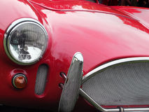 griglia rossa d'annata, fari e chro di rappresentazione del dettaglio dell'automobile sportiva Immagine Stock Libera da Diritti