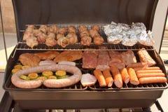 Griglia - salsiccia e carne fotografia stock