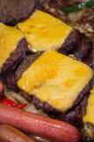 Grigliare gli hamburger degli hot dog Immagini Stock Libere da Diritti