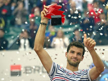 Grigor Dimitrov. ATP Tennis player Grigor Dimitrov pictured raising the trophy of  ATP 250 tournament BRD Nastase Tiriac Trophy. He won the final against Lukas Royalty Free Stock Photos