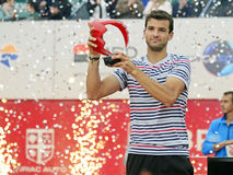 Grigor Dimitrov. ATP Tennis player Grigor Dimitrov pictured raising the trophy of  ATP 250 tournament BRD Nastase Tiriac Trophy. He won the final against Lukas Royalty Free Stock Image
