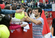 Grigor Dimitrov. ATP Tennis player Grigor Dimitrov signing autographs after the trophy of  ATP 250 tournament BRD Nastase Tiriac Trophy. He won the final against Stock Photo