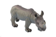 Grijs die rinocerosstuk speelgoed op witte achtergrond wordt geïsoleerd stock afbeeldingen