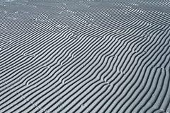 Grijs overzees van textuurgolven zand Stock Foto's