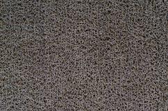 Grijs plastic tapijt Stock Afbeelding
