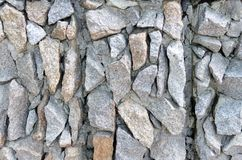 Grijs ruw steenmetselwerk op voorgeveltextuur stock fotografie