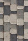 Grijs textuurpatroon van ruwe steen op de weg Stock Fotografie