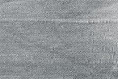 Grijze achtergrond, de achtergrond van denimjeans Jeanstextuur, stof Royalty-vrije Stock Fotografie