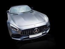 Grijze auto, de autoluxe van Sportenmercedes AMG GT stock afbeelding