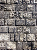Grijze bakstenen muur Stock Foto's